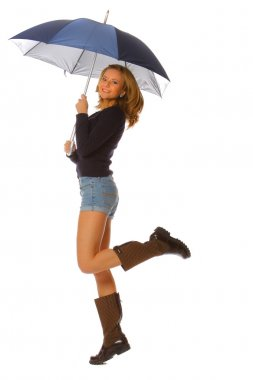 Young woman jumping with umbrella
