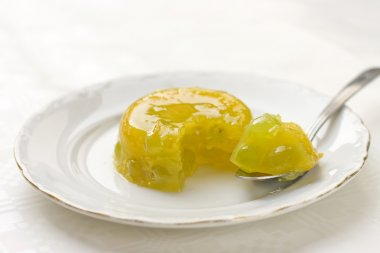Orange gelatin dessert with grape