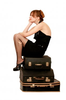 https://static3.depositphotos.com/1001219/126/i/380/depositphotos_1264869-stock-photo-woman-sitting-on-suitcases.jpg