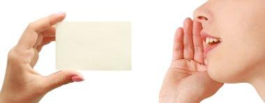 Women talking, business card in hand