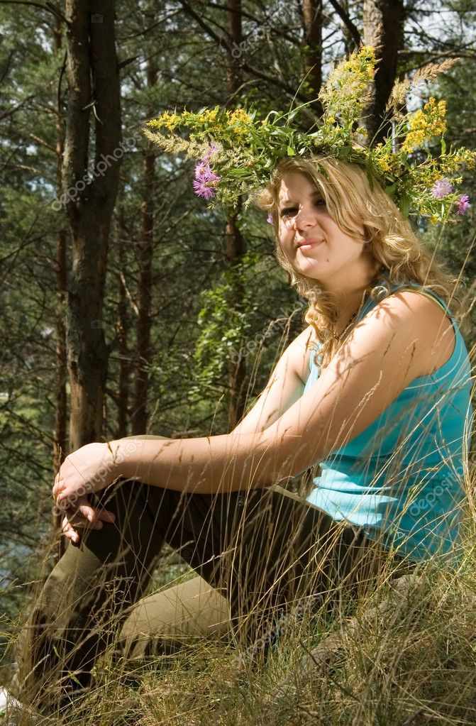 Young beautiful woman in a summer wood