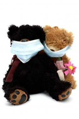 Teddy bears sitting in masks