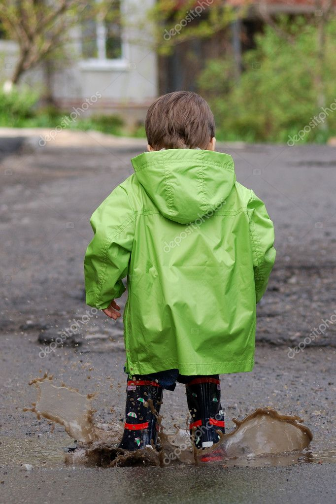 Baby playing in puddles