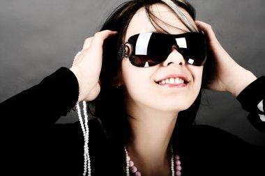 Fashion woman portrait wearing sunglass