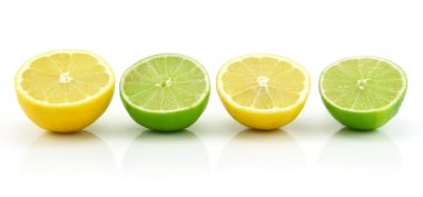 Ripe Sliced Lime and Lemon Isolated on W