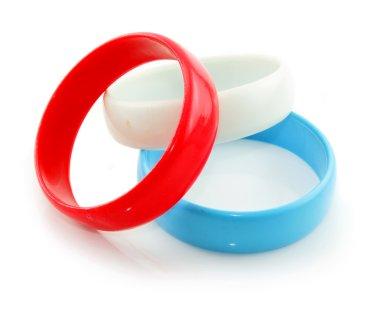 Three colored plastic bracelets isolated
