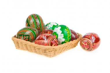 Group of colored easter eggs in basket isolated
