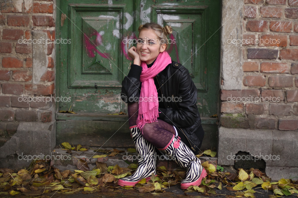 The smiling girl in rubber boots