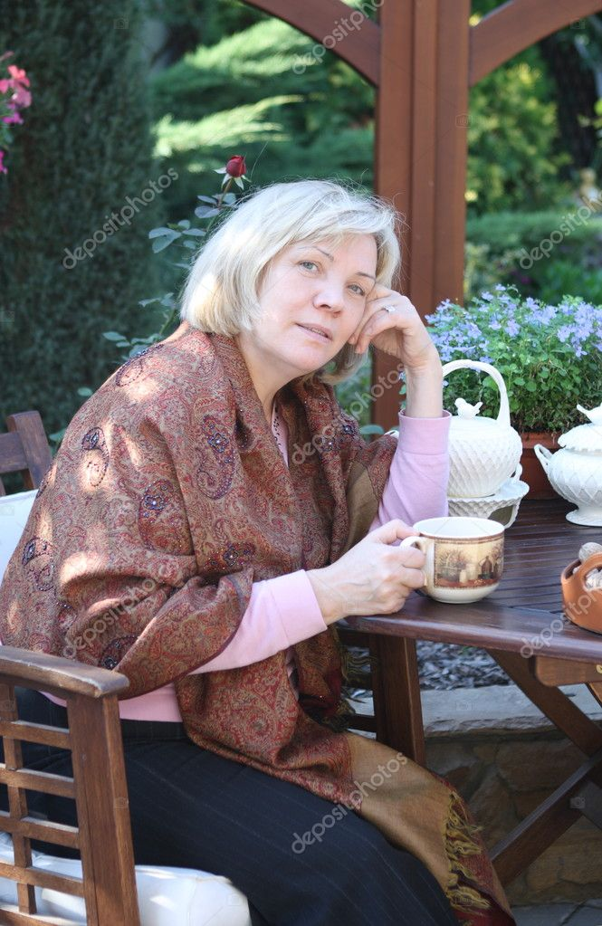 Middle age woman in the autumn garden