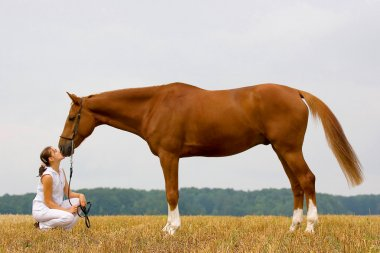 Inseparable-girl and chestnut horse