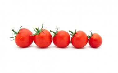 Beautiful Ripe Tomatoes on a white bacgr