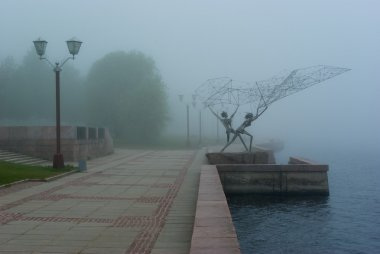 Onega lake embankment in morning fog