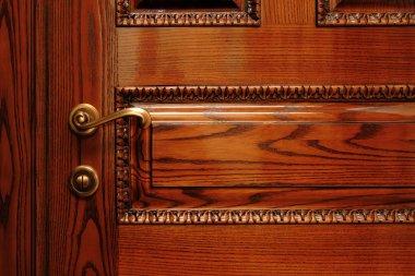 Door handle on the wooden door