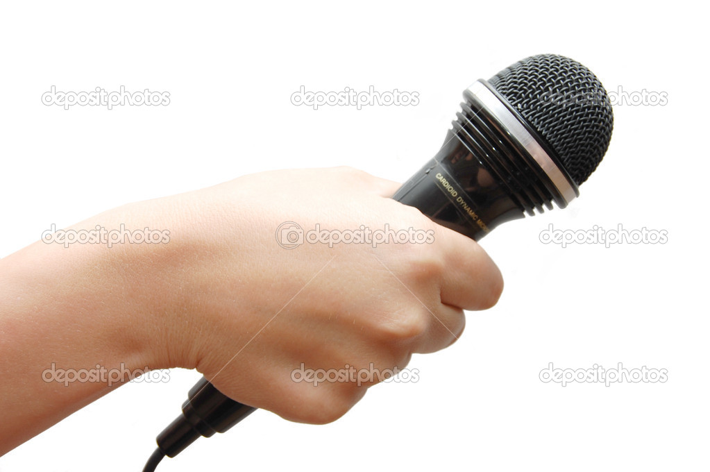 Woman hand holding a microphone