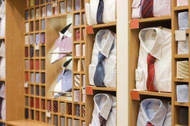 Shelf with men wear in shop