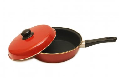 Red frying pan isolated on white