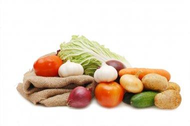 Fresh vegetables and sacking on white