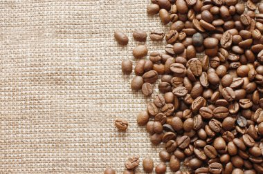 Coffee beans on a burlap texture