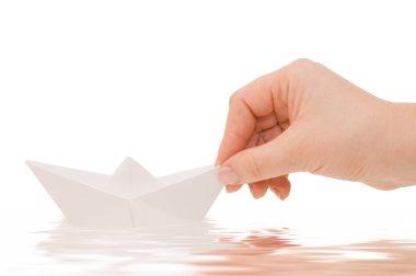 Paper ship in a female hand