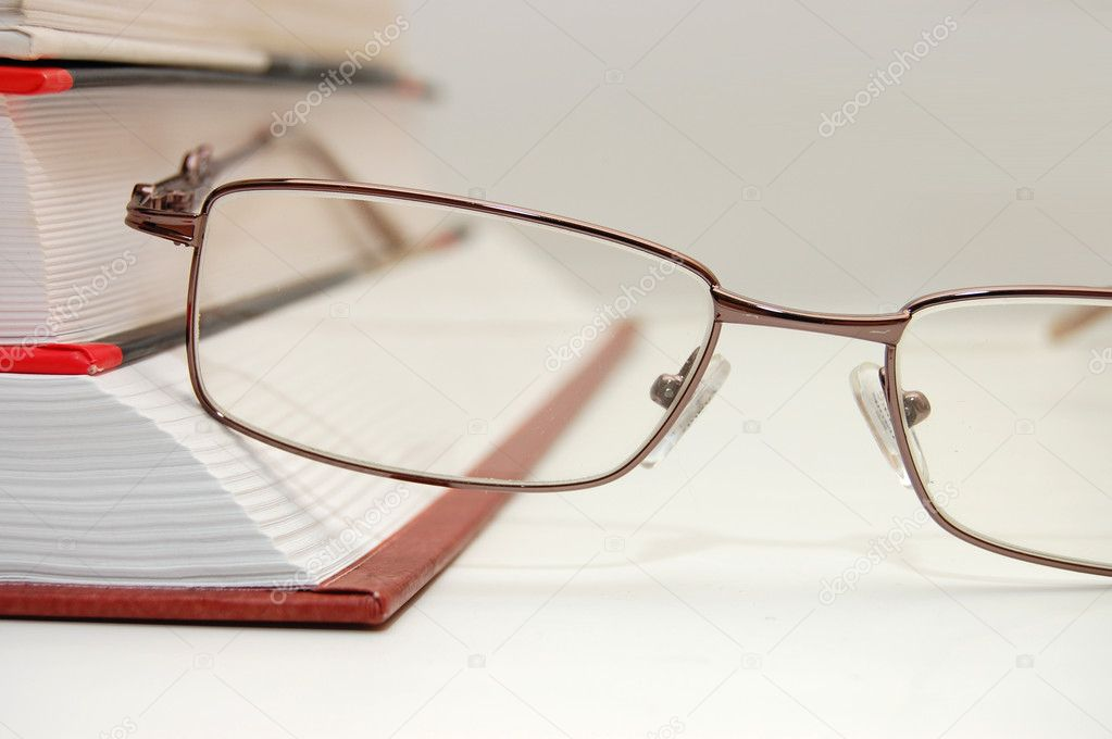 Spectacles laying on the closed book — Stock Photo © voronin-76 #2638207