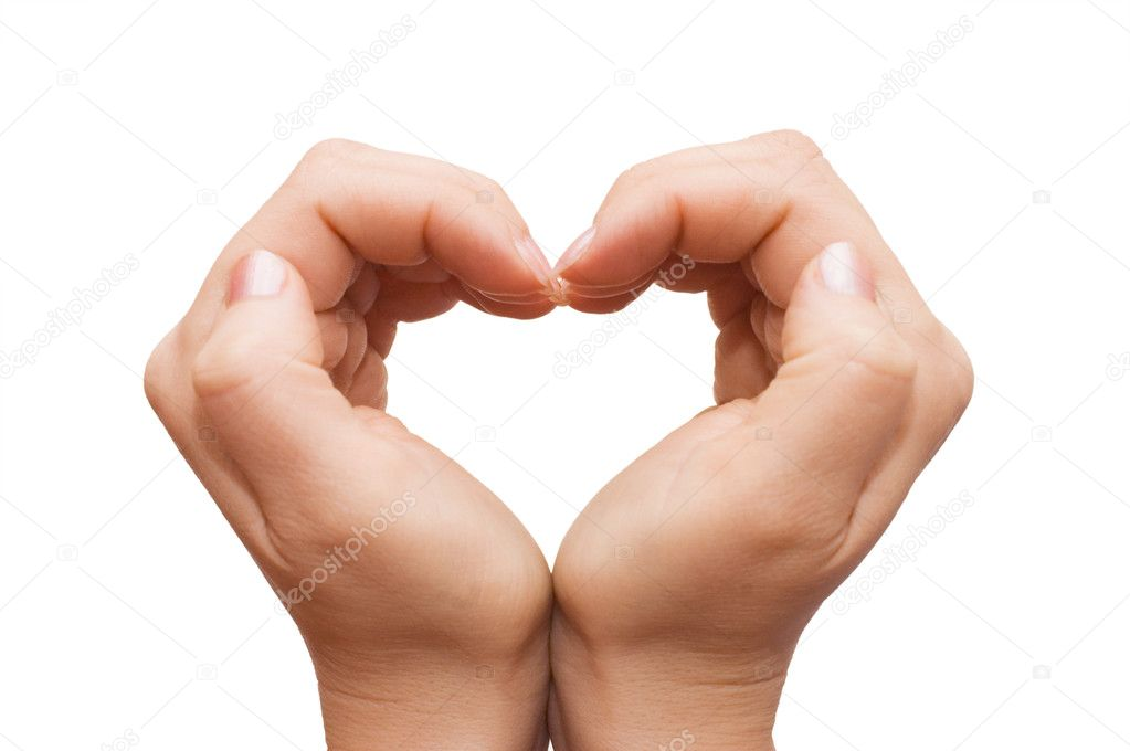 Hands forming a heart on white