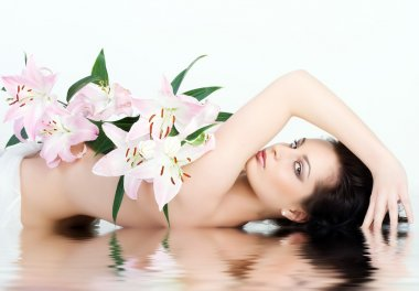 Beautiful Woman With The Pink Flowers.