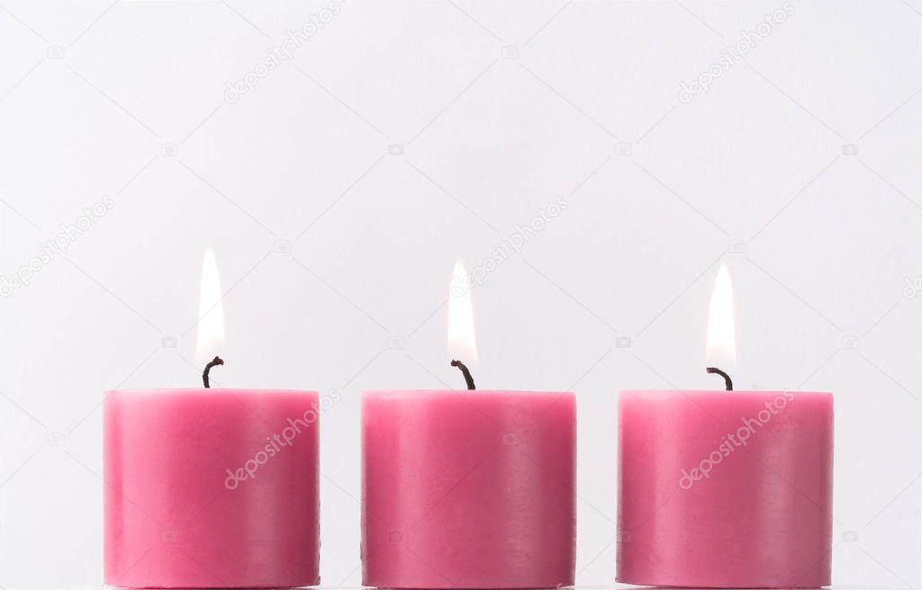 Licht Roze Kaarsen : Drie roze kaarsen u stockfoto de kay