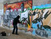 Graffity festő rajz egy képet a falra