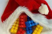 Building blocks on Santa Claus cap
