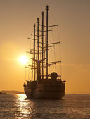 Sailing yacht for trip at sunset