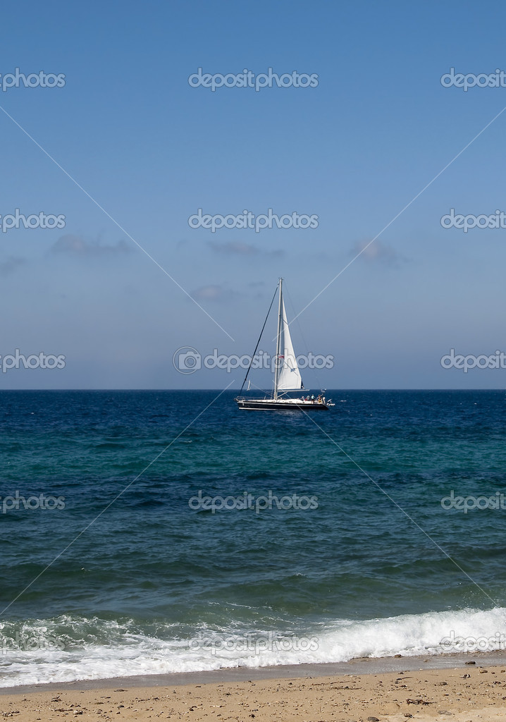 Small yacht in the blue sea