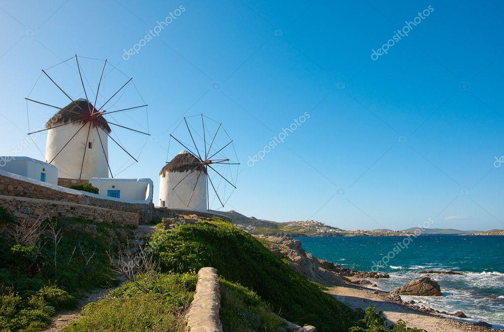 Windmills on a hillside near the sea