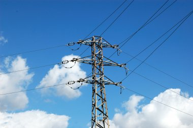 Low angle view of electricity pylon on blue sky background stock vector