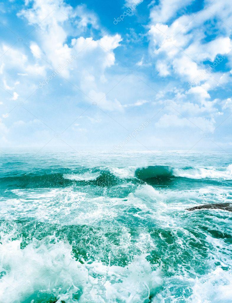 Sea waves and the blue sky