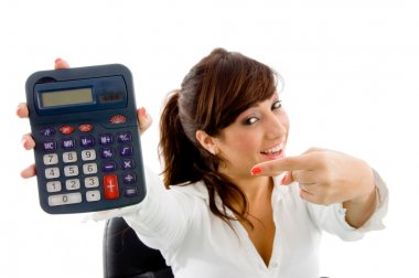Smiling woman pointing at calculator