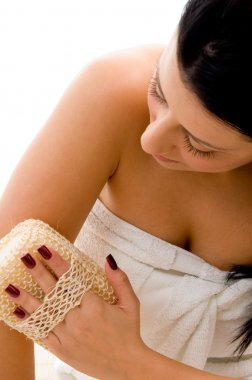 Young woman scrubbing her arms