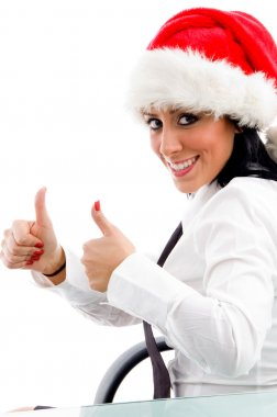 Christmas lady showing thumbs up