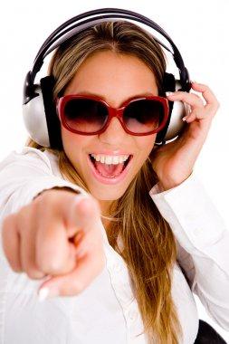 Pointing female enjoying music