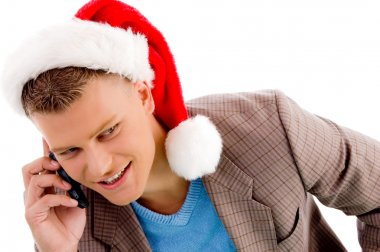 Man with christmas hat talking on mobile