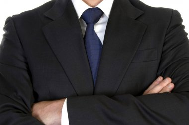 Businessman in suit with crossed arms