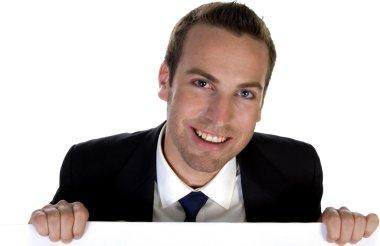 Businessman holding white board