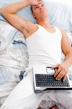 Man resting at his home with laptop
