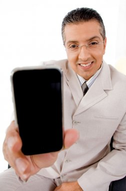 Businessman offering cell phone