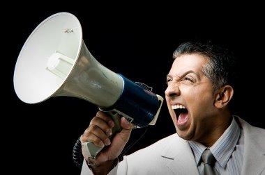 Manager shouting through megaphone