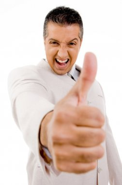 Successful man showing thumbs up