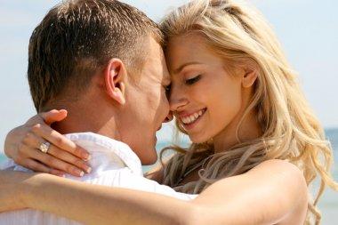 Mischievous couple embracing
