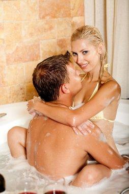 Man embracing woman in bath