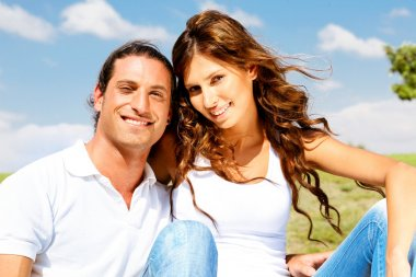 Young couple posing in front of camera