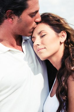 Young man kissing his girl