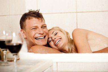 Couple having fun in bath